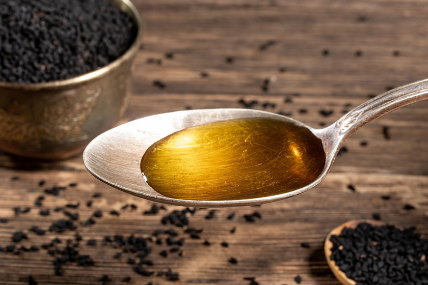 Black Cumin Seeds and a Spoonfull of Oil