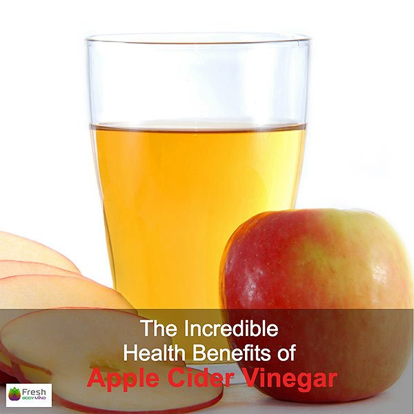 Tall Glass of Healthy Apple Cider Vinegar with Apples Surrounding
